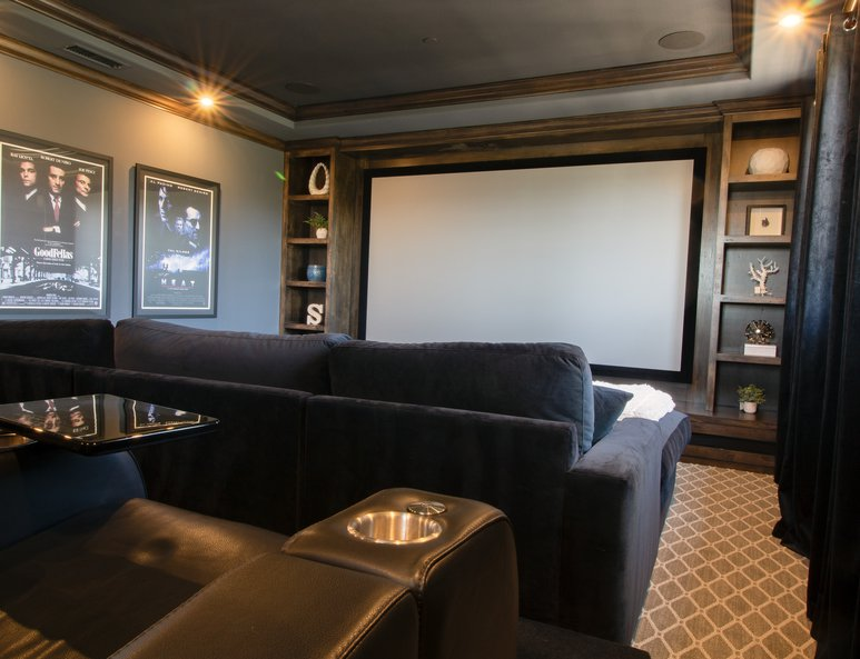 Home theater addition with dark wood moulding and coffered ceiling