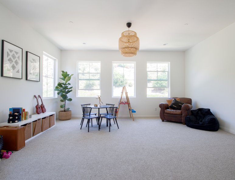 Large playroom with ample lighting and seating area