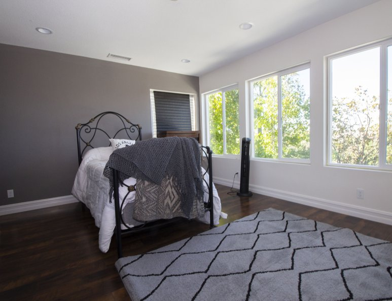 Guest bedroom with ample lighting.