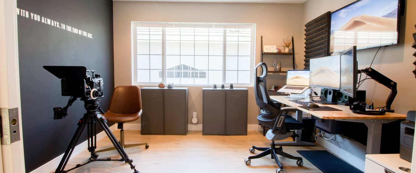 Home office with double pocket doors and ample lighting