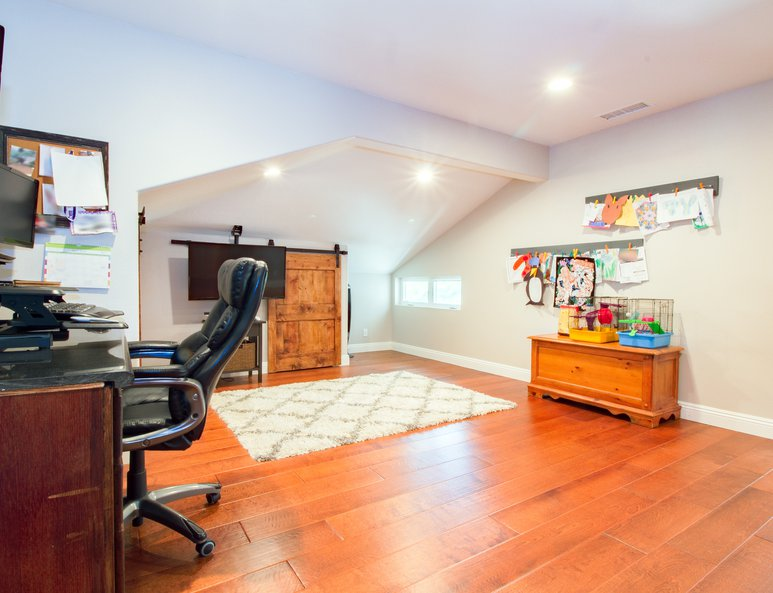 Open loft with sliding door storage, desk area and plenty of room for more