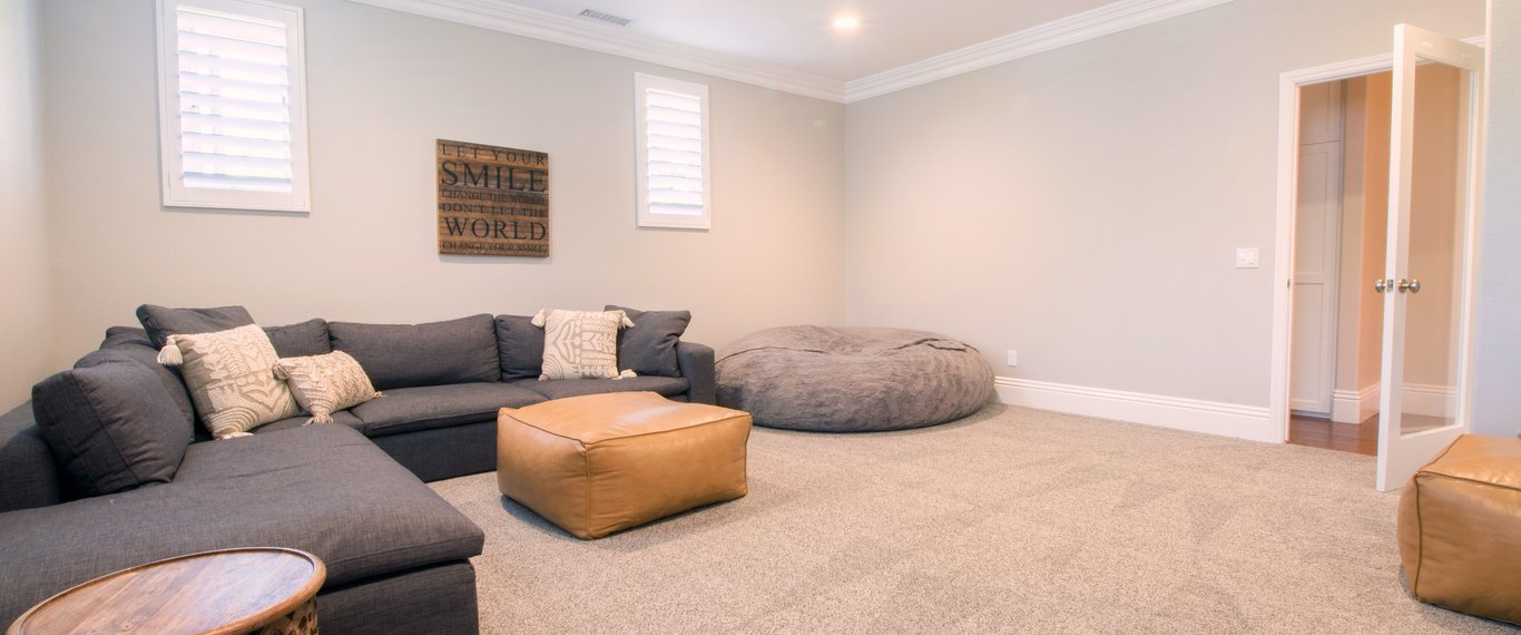 Newly added family room with ample lighting.