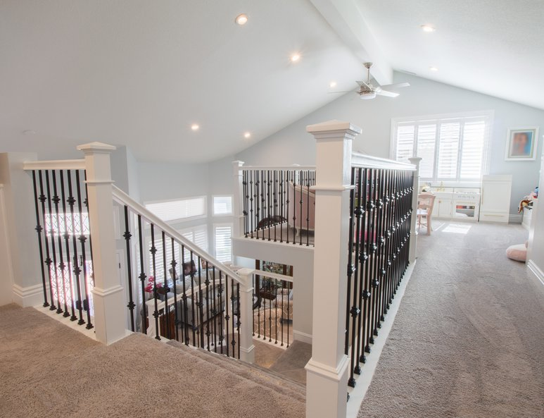 Beautifully reconfigured stairs leading to a newly added open loft playroom.